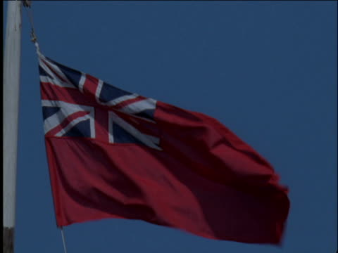 red ensign nautical flag flutters against blue sky liverpool - bandiera inglese video stock e b–roll