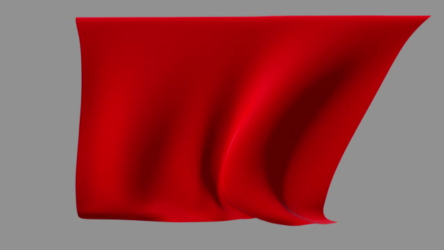Red fabric waving from a ceiling