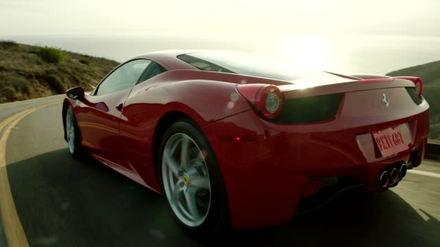 vídeos y material grabado en eventos de stock de red ferrari driving down malibu canyon with pacific ocean in background - ferrari