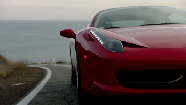 red ferrari driving up malibu canyon - sportwagen stock-videos und b-roll-filmmaterial