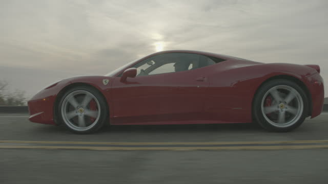 red ferrari - wealth stock videos & royalty-free footage