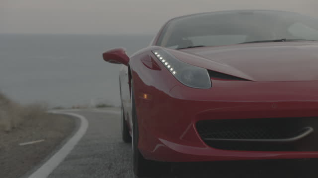 red ferrari - luxus stock-videos und b-roll-filmmaterial