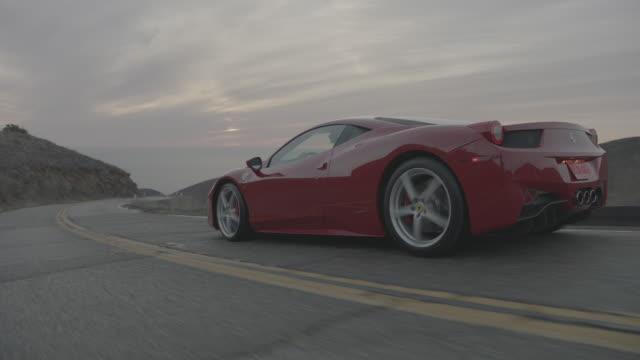 red ferrari - sportwagen stock-videos und b-roll-filmmaterial