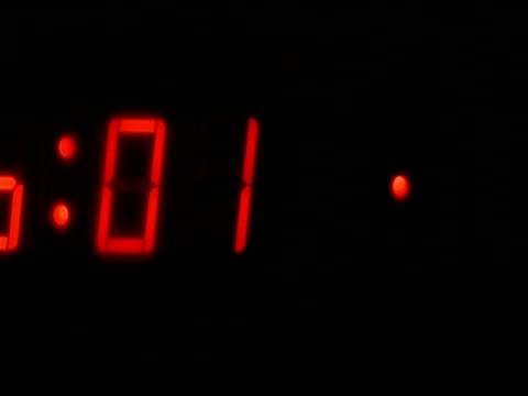 red figures on electronic clock count from zero to five - digital clock stock videos & royalty-free footage