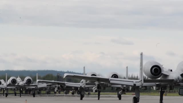 Red Flag Alaska flight line operations and take offs featuring F15 Eagles F16 Fighting Falcons A10 Thunderbolts
