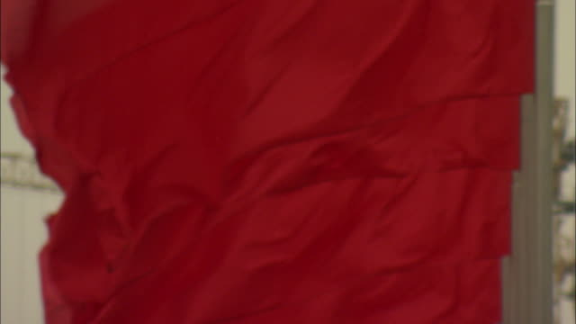 cu tu td red flag blowing in wind in tiananmen square, beijing, china - chinese flag stock videos & royalty-free footage