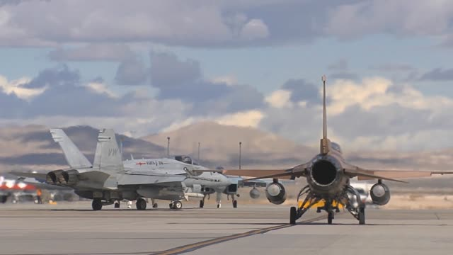 red flag operations on nellis air force base red flag a realistic combat training exercise involving the air forces of the united states and its... - nellis air force base stock videos and b-roll footage