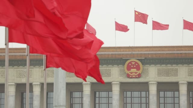 Red flags flying outside the Great Hall of the People following a group session at the first session of the 13th Chinese People's Political...
