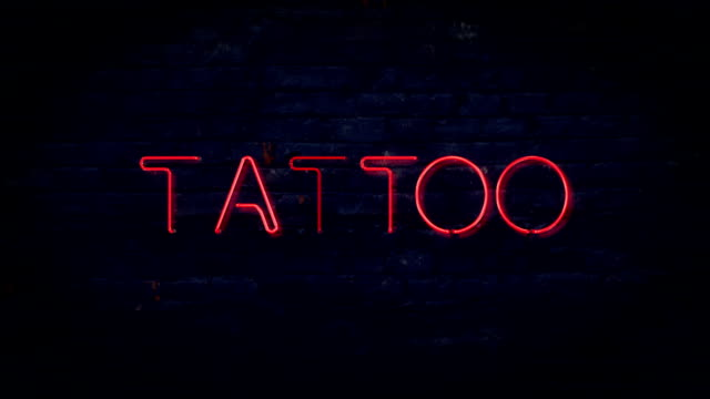 Red flashing tattoo neon sign