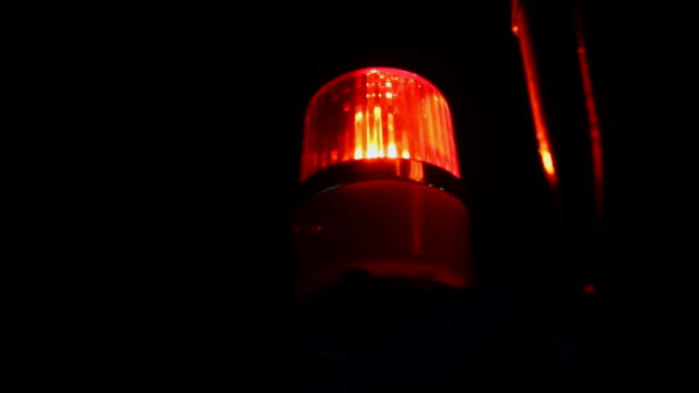 Red flashing warning siren light