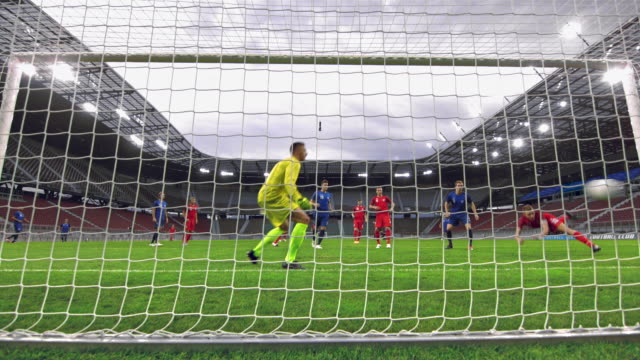 stockvideo's en b-roll-footage met ld red football team scoring a goal at a match - sportwedstrijd