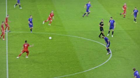 red football team scoring with a header - aspirations点の映像素材/bロール