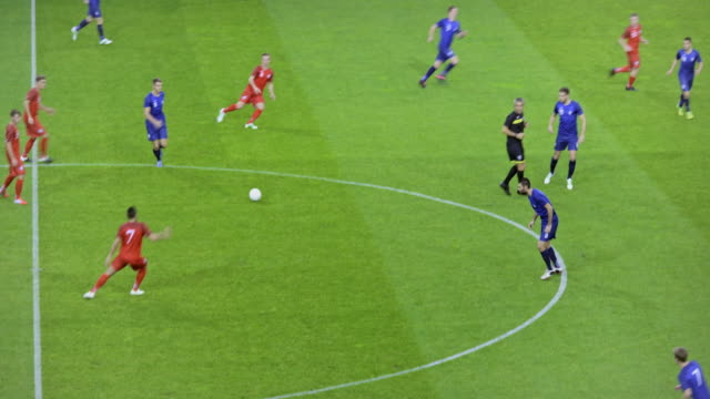stockvideo's en b-roll-footage met red football team scoring with a header - sportwedstrijd