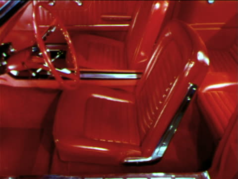 1965 red front seats + steering wheel of ford mustang / industrial - ford mustang stock videos and b-roll footage