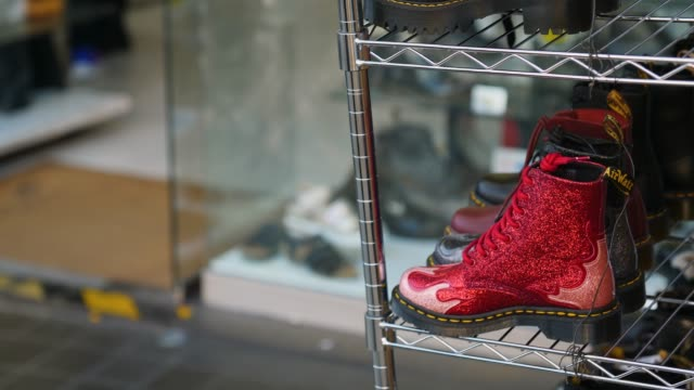 red glitter dr. martens boots on display, camden - street style点の映像素材/bロール