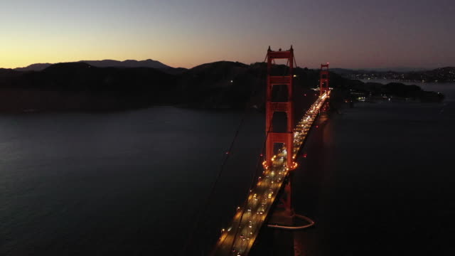 red golden gate bridge under a foggy sky (dusk) - 1937 stock videos & royalty-free footage