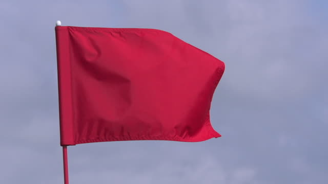 """""""red golf flag in the wind, near sciacca in sicily, italy, slow motion"""" - golf flag stock videos and b-roll footage"""