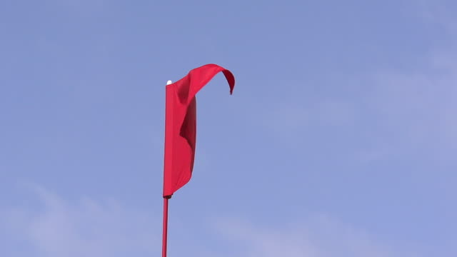 """red golf flag in the wind, near sciacca in sicily, italy, slow motion"" - 旗点の映像素材/bロール"