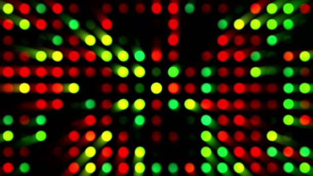 red, green, and yellow music video background | shiny multicoloured grid of dots with random generative effect on black background - dance music stock videos & royalty-free footage