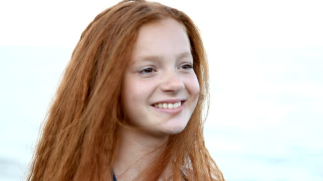 red haired teenage girl posing, flirting against the sea - eastern european culture stock videos & royalty-free footage