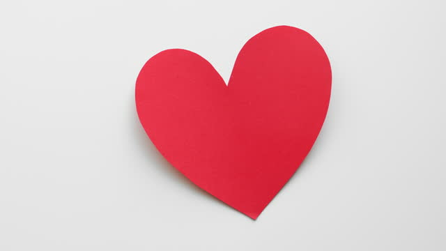 red hearts for valentine's day appear on white background - stop motion animation stock videos & royalty-free footage