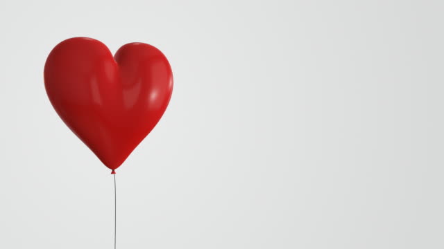 red heart-shaped balloon - loopable | 4k - balloon stock videos and b-roll footage
