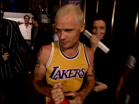 Red Hot Chili Peppers arriving on the red carpet of the 1995 MTV Video Music Awards Flea giving the middle finger and chatting with reporters