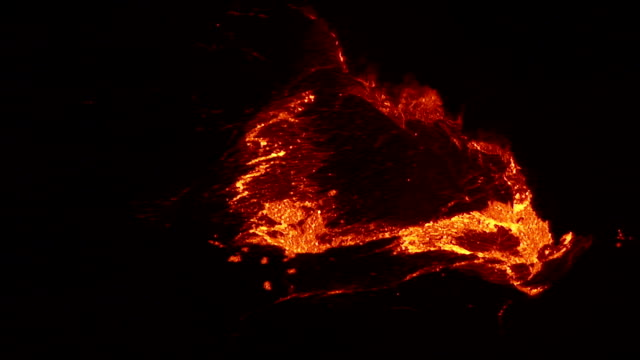 Red hot molten lava splits a thin surface crust. Available in HD.