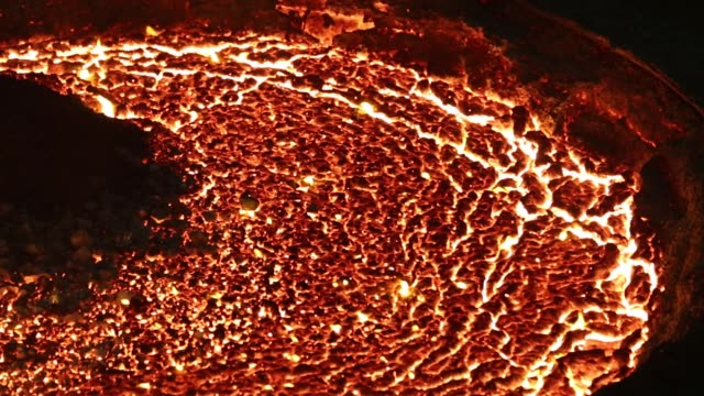 Red hot molten steel is poured from an arc furnace cauldron in the steel smelting shop at the Oskol Elektrometallurgical Plant steel mill operated by...