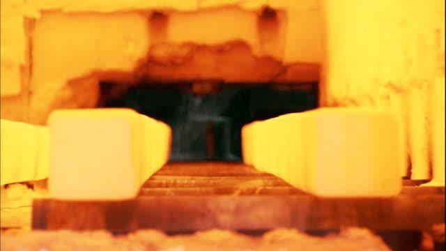 CU Red hot slab of steels on conveyor being cooled by spray of water / Kyungsangnamdo, South Korea