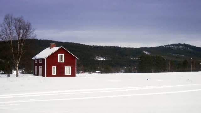 A Red House In Winter Landscape Sweden Stock Footage Video