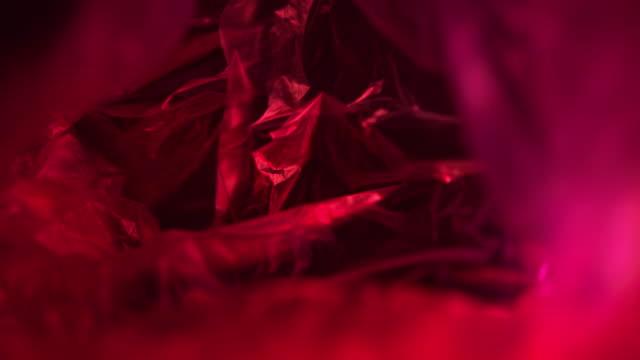 vídeos de stock e filmes b-roll de red illuminated plastic bag - saco de plástico