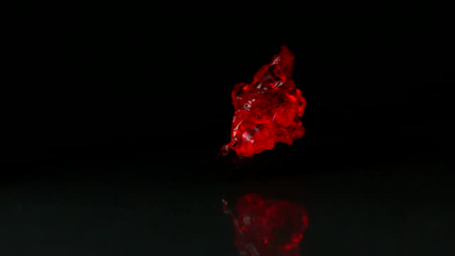 red jelly falling and bouncing on black background - gelatin stock videos & royalty-free footage