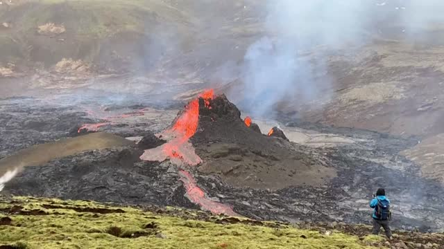 red lava spews from a volcano near iceland's capital reykjavik as onlookers take photos. the first eruption in 900 years is beginning to subside, and... - iceland stock videos & royalty-free footage