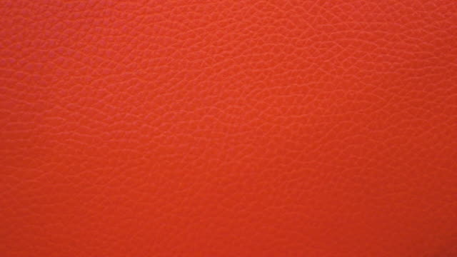 red leather background shot on smartphone - leather stock videos & royalty-free footage