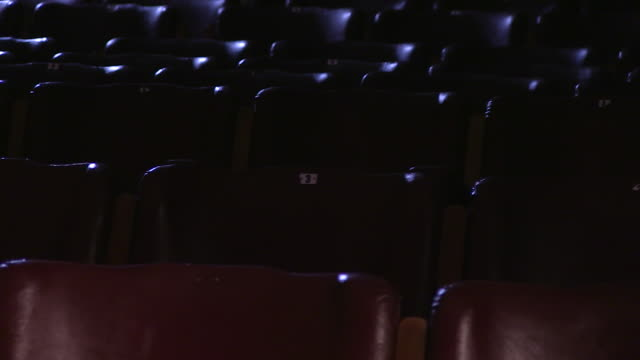red leather cinema chairs - auditorium stock videos & royalty-free footage