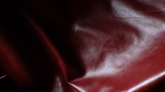 red leather texture in super slow motion - maroon stock videos and b-roll footage