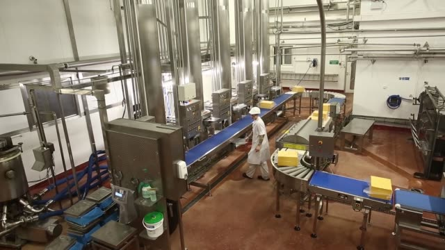 Red Leicester cheese during the manufacturing process at Wyke Farms Ltd in Bruton UK on Friday Sept 27 An employee checks cheese during production...