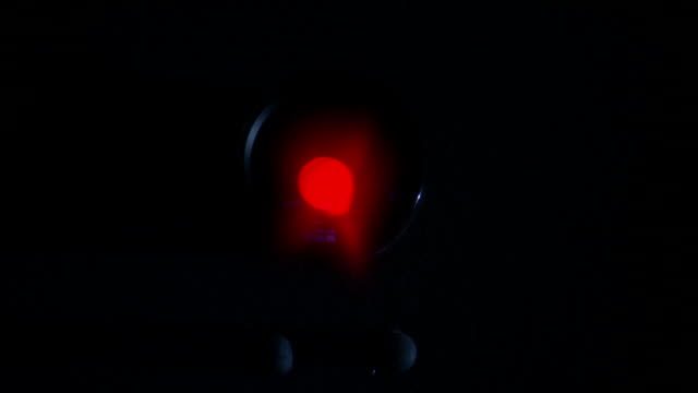 a red light blinks on a small surveillance camera. - blinking stock videos & royalty-free footage