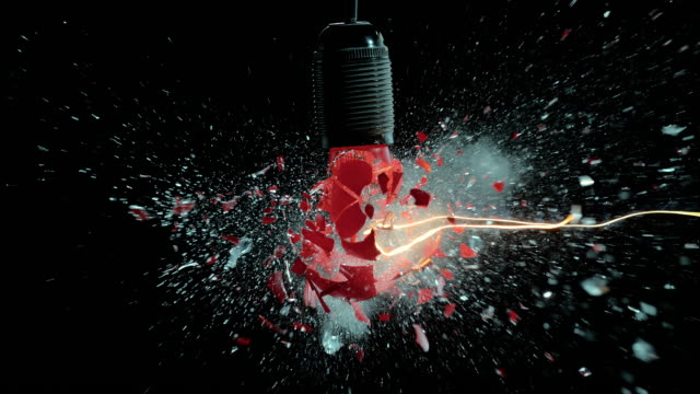 slo mo red light bulb explosion - creativity stock videos & royalty-free footage