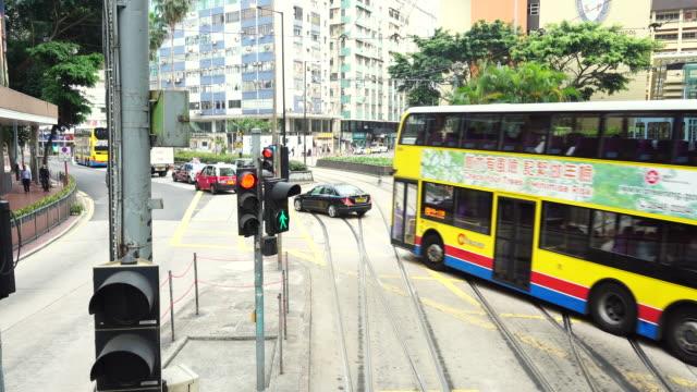 red light, car bus passed by, tram hong kong island - hong kong island stock videos & royalty-free footage