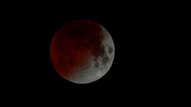 "red light crosses moon during a lunar eclipse - ""bbc universal"" stock videos & royalty-free footage"