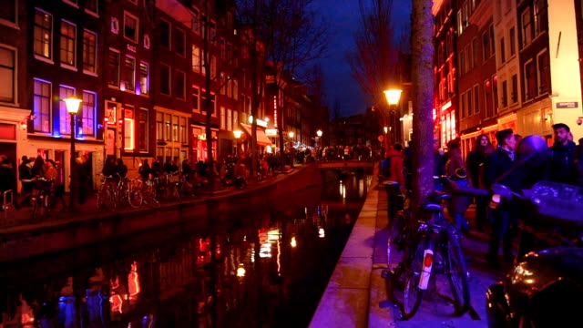 red light destrict view and amsterdam canal, bicycles and cyclists, houseboats, living boats. (ed) - amsterdam stock videos & royalty-free footage