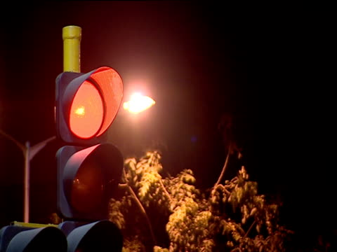 red light flashing on traffic lights bombay - road signal stock videos & royalty-free footage