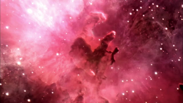 red light shines from a nebula in space. - atmosphäre stock-videos und b-roll-filmmaterial