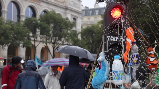 red light with plastic waste and stuffed fish. the activists of the ecologist movement extinction rebellion have paralyzed the place du châtelet and... - road signal stock videos & royalty-free footage