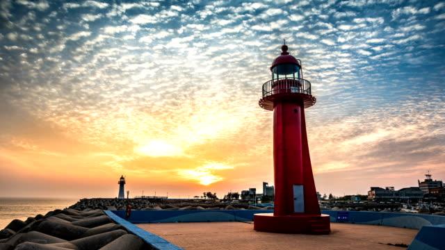 red lighthouse and blue lighthouse at bieunghang harbor at day to night - leuchtturm stock-videos und b-roll-filmmaterial