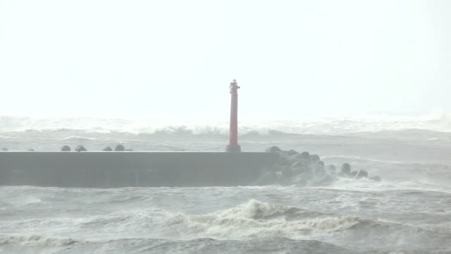 red lighthouse in a hurricane - typhoon stock videos and b-roll footage