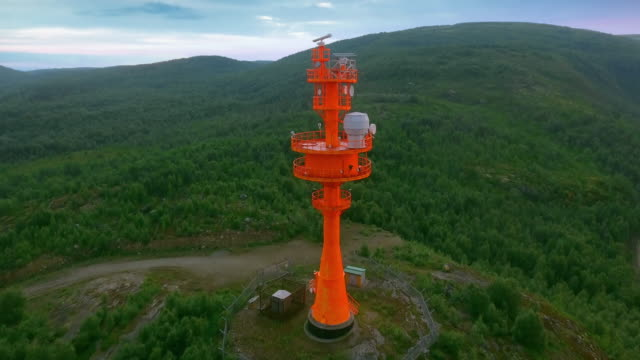 red lighthouse with radar. coastal surveillance radar antenna - fare la guardia video stock e b–roll