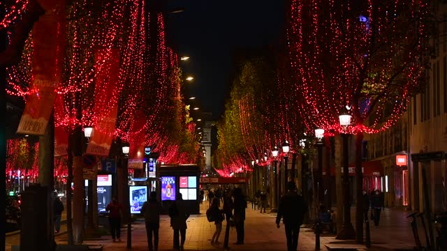 red lights decorate the trees to illuminate the champs-elysees avenue for christmas and new year celebrations on november 24, 2020 in paris, france. - avenue stock videos & royalty-free footage